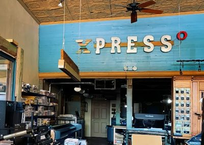 Xpresso Print Cafe room with blue facade