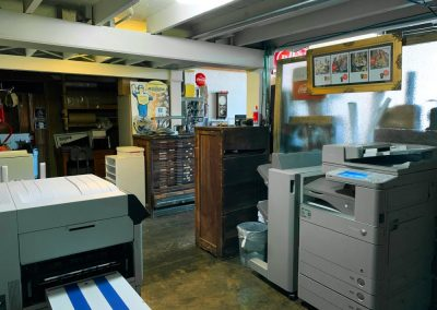 Xpresso Print Cafe back hallway with printer and OKI printer