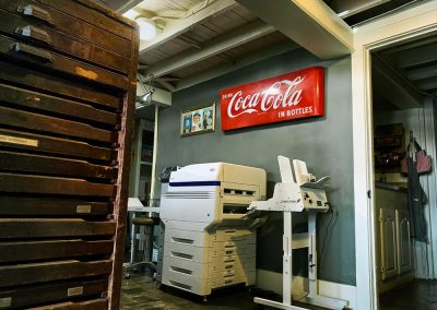 Xpresso Print Cafe antique type cabinet back wall with old wooden type cabinet and printer