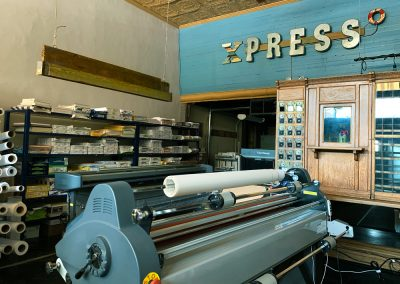 Xpresso Print Cafe in print room with large format printer